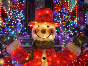 Christmas outdoor Christmas decorations - Snowman lights up house in Brooklyn, New York